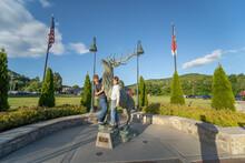 Boys Posing With Statue Of Elk In Banner Elk NC