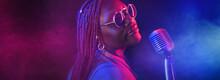 Black African Woman In Sunglasses In Butem Neon Light - Glamor Show