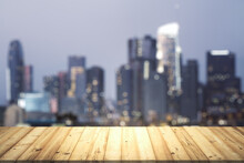Table Top Made Of Wooden Dies With Blurry City View At Dusk On Background, Template