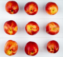 Top View Of Fresh Ripe Nectarines Isolated On White Background