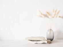 Grey Natural Stones Podium On White Background, Platform For Product Display And Dry Branches In Vase
