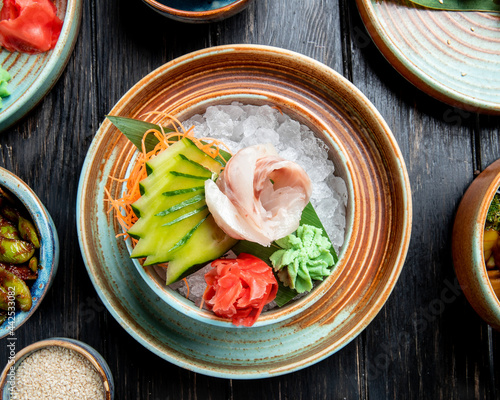 top view of marinated herring fillets with sliced cucumbers ginger and wasabi sa Fototapeta