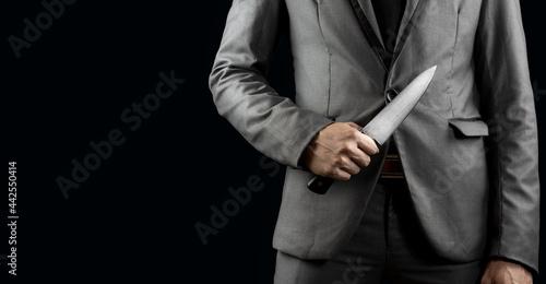 Slika na platnu businessman holding knife for blackmail concept.