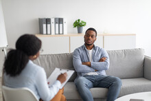 Psychological Counselling. Black Male Patient With Depression Having Session With Psychotherapist At Office