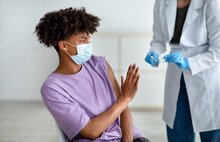 Black Teen Stopping Medical Worker From Making Covid Vaccine Shot, Being Afraid Of Coronavirus Immunization At Clinic