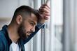 Leinwandbild Motiv Depressed caucasian man losing job and heartbroken at same time alone, feeling bad and expresses negative