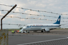 A Plane On The Territory Of The Airport Against The Background Of Barbed Wire. Closed Territory Of A Private Airfield. Emergency Landing Of The Aircraft. The Plane Is On The Runway.