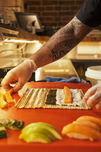 Crop Man Preparing Sushi In Asian Restaurant