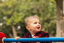 Happy Baby Playing In A Park