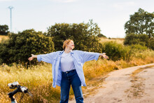 Blonde Young Woman Enjoying Nature In A Field