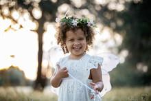 Cute Girl In Fairy Costume In Nature