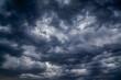 Leinwandbild Motiv Stormy black clouds close the sky to the horizon. Dark thunderstorm clouds all over sky create an incredibly menacingly beautiful pattern.