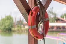 Orange Lifebuoy Wheel Hang By The Water