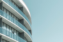 Modern European Residential Apartment Building With Balconies On Blue Sky Background