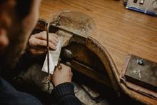 Crop Jeweler Sawing Metal On Workbench