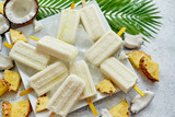 Fototapeta Kawa jest smaczna - Homemade vegan popsicles made with coconut milk and pineapple. Delicious healthy summer snack