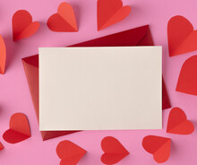 White Paper And Red Hearts Are Placed On A Pink Background.
