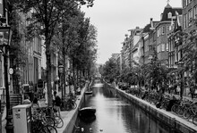 AMSTERDAM, NETHERLANDS. JUNE 06, 2021. Beautiful View Of Amsterdam With Typical Dutch Houses, Bridges And Chanel.