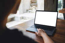 Mockup Image Of A Woman Using And Touching On Laptop Touchpad With Blank White Desktop Screen