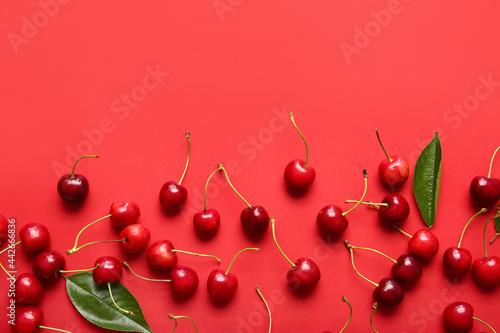 Tasty ripe cherry on color background Fototapet