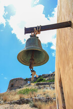An Old Bell Hanging On The Wall Of An Orthodox Chapel