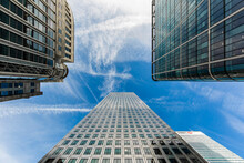 London Skyscrapers View From Below With Blue Sky And Buildings With Lots Of Windows And Vanishing Point With Copy Space