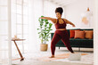 Healthy woman doing yoga at home