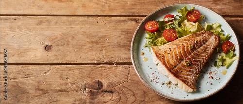 Obraz na plátně Tasty fish on plate with vegetables