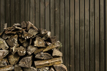 Firewood Piled Up In The Corner Of The Hut