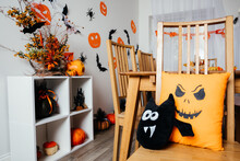 Halloween Style Pillows Placed On Wooden Chair