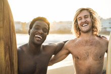 Happy Multiracial Surfers Having Fun On The Beach After Surf Session - Soft Focus On African Man Face