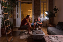 Men Relaxing In Evening At Home