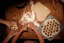Children In The Kitchen Sculpt Prepare Dumplings, Evening Photo, Dark Style