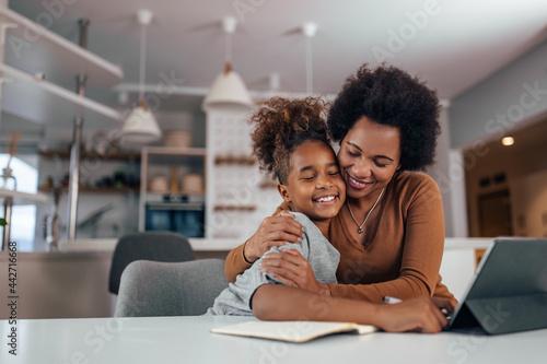 Obraz na plátně Mother and daughter embracing each other.