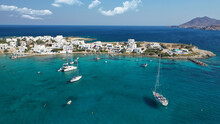 Aerial Drone Photo Of Picturesque Fishing Village Of Polonia Or Pollonia With Traditional Fishing Boats Anchored Next To Island Of Kimolos, Milos Island, Cyclades, Greece