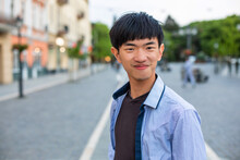 Attractive Young Student On Old European City Background