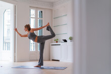 Serene Woman Doing Yoga In Lord Of The Dance Pose