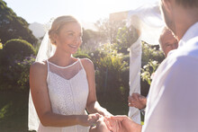 Happy Caucasian Bride And Groom Getting Married Holding Hands Vowing