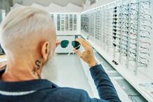 Senior Man With Stylish Sunglasses In Optical Store