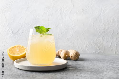Fotografie, Obraz Healthy kombucha beverage in glass with lemon and ginger