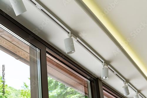 Fototapeta Modern lamps under the ceiling as an interior element.