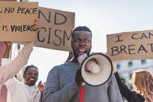 Black Man Protesting With Megaphone In Street