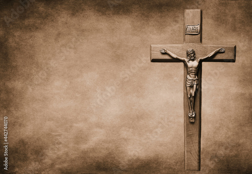 Closeup shot of a Sepia-toned crucifix with the body of Christ on a large backgr Fotobehang