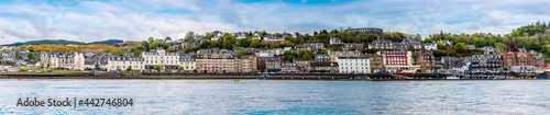 Fotografie, Obraz A panorama view of seafront of the  town of Oban, Scotland from Oban Bay on a su