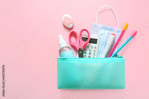 Photo School supplies set top view on pink empty space background