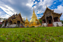 Tourist Visiting Wat Phra Singh Temple One Of The Best Examples Of Classic Lanna Style Architecture In Chiang Mai Province Of Thailand.