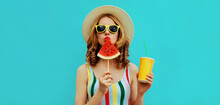 Summer Colorful Portrait Of Beautiful Young Woman Drinking Juice With Lollipop Or Ice Cream Shaped Slice Of Watermelon Wearing A Straw Hat On Blue Background