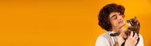 Smiling Man Holding Cat Isolated On Orange, Banner