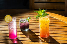 Tropical Inspired Cocktails In Bold Colors And Shapely Glasses