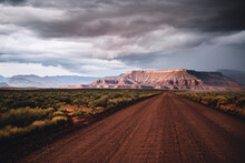 Clearing Storm And Gravel Road In Red Rock Desert, Southern Utah